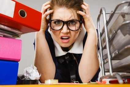 Woman looking stressed at desk : Emotional Mastery for the small business owner concept
